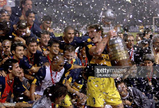 Boca Juniors team captain Martin Palermo holds the Libertadores Cup trophy won after defeating Gremio by 20 20 June 2007 in their final match played...