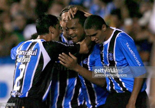 Gremio's Moacir Tuta celebrates with teammates after scoring against Tolima during their Libertadores Cup football match in Porto Alegre southern...