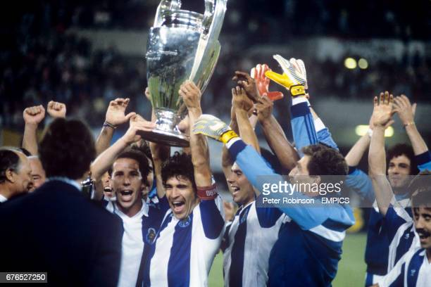 FC Porto captain Joao Pinto lifts aloft the European Cup after his side beat Bayern Munich 21 Also picture are teammates Jaime Magalhaes Antonio...
