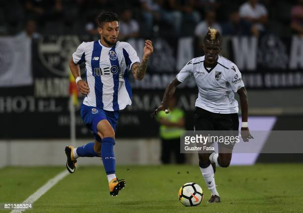 Porto defender Alex Telles from Brazil with Vitoria Guimaraes defender Falaye Sacko from Mali in action during the PreSeason Friendly match between...