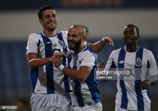 Porto defender Ivan Marcano from Spain celebrates with teammate FC Porto midfielder Andre Andre from Portugal after scoring a goal during the...