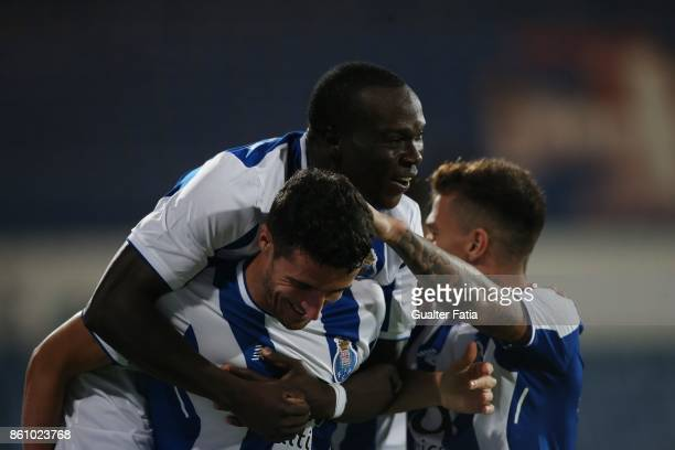 Porto defender Ivan Marcano from Spain celebrates with teammate FC Porto forward Vincent Aboubakar from Cameroon after scoring a goal during the...