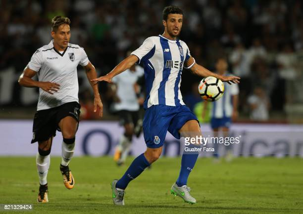 Porto defender Ivan Marcano from Spain with Vitoria Guimaraes forward David Texeira from Uruguay in action during the PreSeason Friendly match...