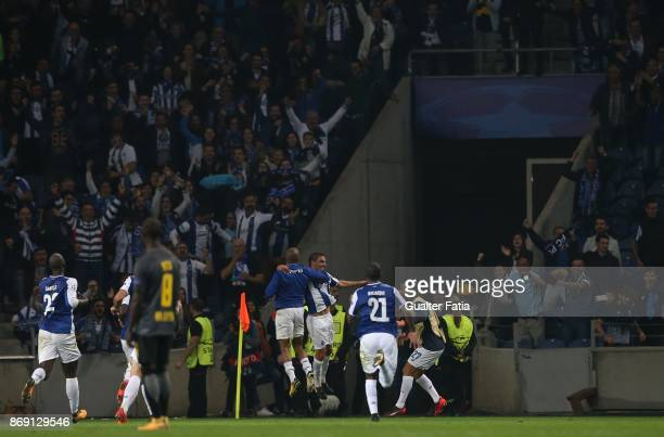 Porto defender Maxi Pereira from Uruguay celebrates with teammates after scoring a goal during the UEFA Champions League match between FC Porto and...