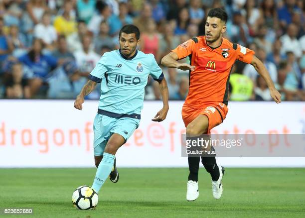 Porto forward Jesus Corona from Mexico with Portimonense SC midfielder Pedro Sa from Portugal in action during the PreSeason Friendly match between...