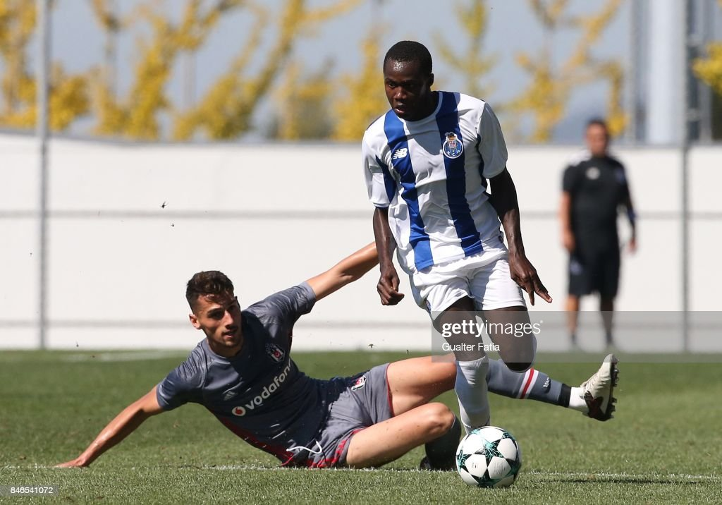 FC Porto forward Madi Queta with Besiktas defender Alpay Celebi from Turkey in action during the UEFA Youth League match between FC Porto and Besiktas JK at Centro de Estagios do Olival on September 13, 2017 in Olival, Portugal.