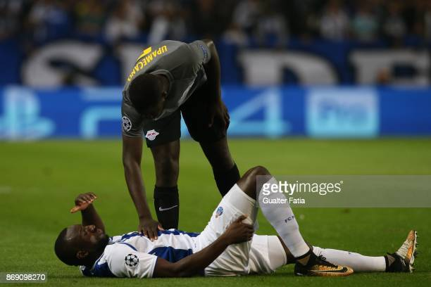 Porto forward Moussa Marega from Mali injured talks to RB Leipzig defender Dayot Upamecano from France during the UEFA Champions League match between...