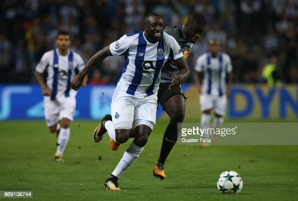 Porto forward Moussa Marega from Mali with RB Leipzig defender Dayot Upamecano from France in action during the UEFA Champions League match between...