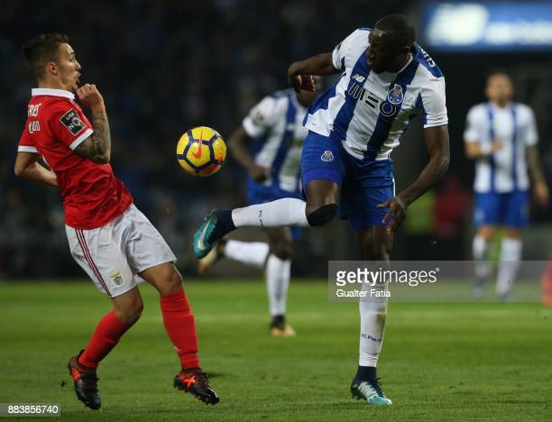 Porto forward Moussa Marega from Mali with SL Benfica defender Alejandro Grimaldo from Spain in action during the Primeira Liga match between FC...