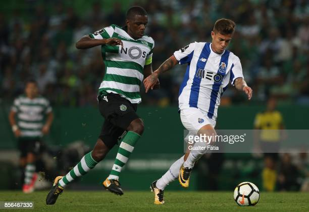 Porto forward Otavio from Brazil with Sporting CP midfielder William Carvalho from Portugal in action during the Primeira Liga match between Sporting...