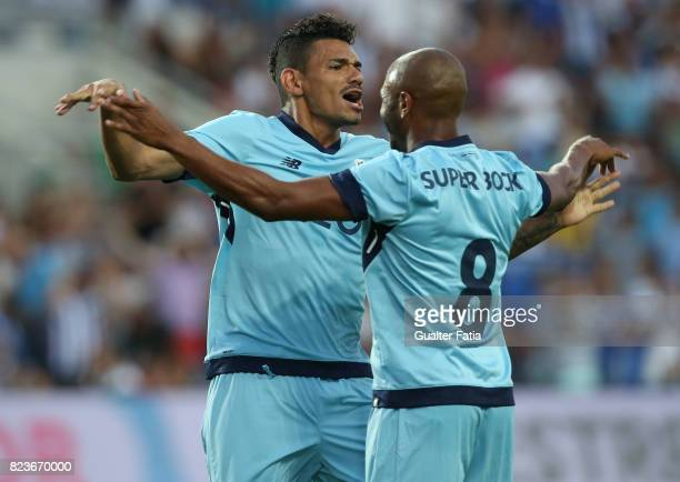 Porto forward Soares from Brazil celebrates with teammate FC Porto forward Yacine Brahimi from Algeria after scoring a goal during the PreSeason...