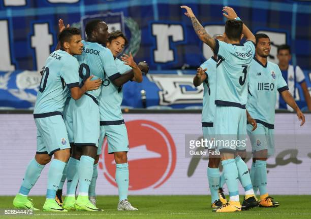 Porto forward Vincent Aboubakar from Cameroon celebrates with teammates after scoring a goal during the PreSeason Friendly match between Portimonense...