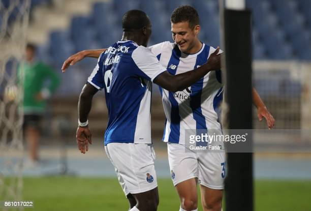 Porto forward Vincent Aboubakar from Cameroon celebrates with teammate FC Porto defender Diogo Dalot from Portugal after scoring a goal during the...