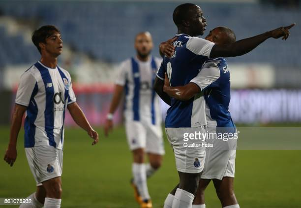 Porto forward Vincent Aboubakar from Cameroon celebrates with teammate FC Porto forward Yacine Brahimi from Algeria after scoring a goal during the...