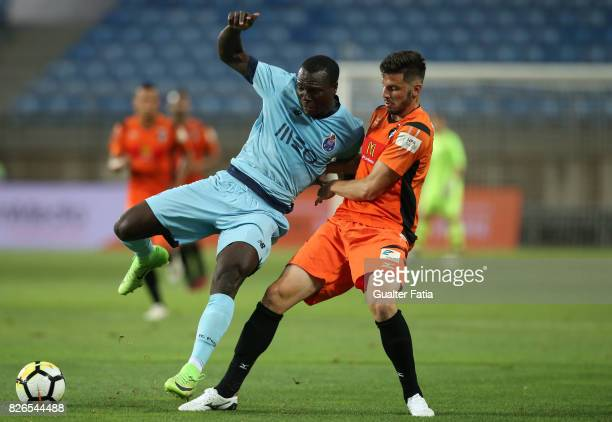 Porto forward Vincent Aboubakar from Cameroon with Portimonense SC defender Lucas Possignolo from Brazil in action during the PreSeason Friendly...