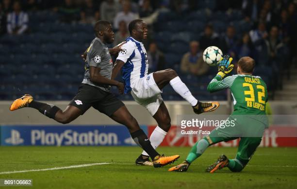 Porto forward Vincent Aboubakar from Cameroon with RB Leipzig defender Dayot Upamecano from France and RB Leipzig goalkeeper Peter Gulacsi from...