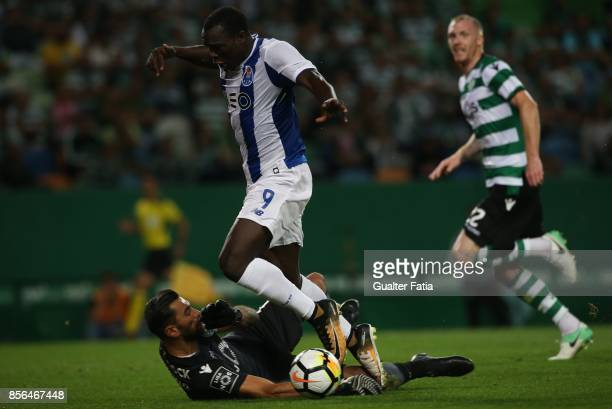 Porto forward Vincent Aboubakar from Cameroon with Sporting CP goalkeeper Rui Patricio from Portugal in action during the Primeira Liga match between...