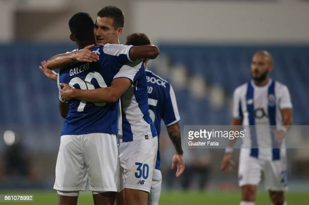 Porto forward Wenderson Galeno from Brazil celebrates with teammate FC Porto defender Diogo Dalot from Portugal FC Porto midfielder Andre Andre from...