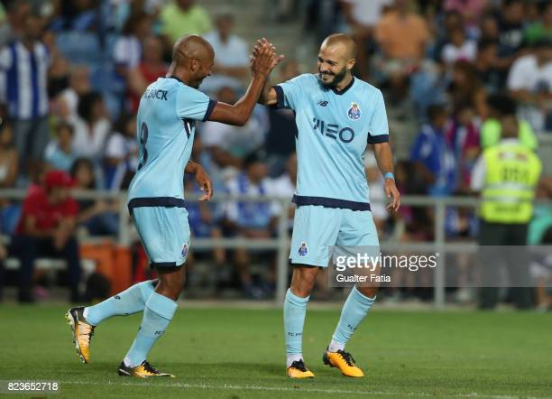 Porto forward Yacine Brahimi from Algeria celebrates with teammate FC Porto midfielder Andre Andre from Portugal after scoring a goal during the...