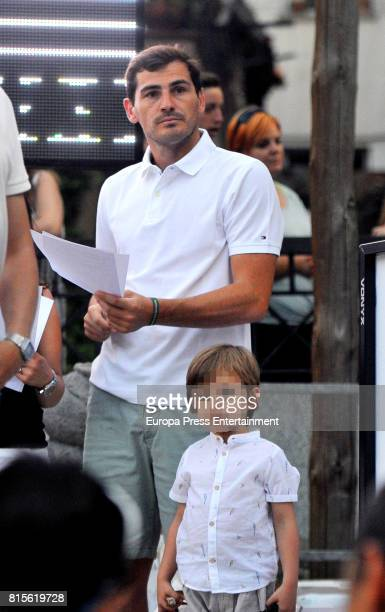 Part of this image has been pixellated to obscure the identity of the child Porto goalkeeper Iker Casillas and son Martin Casillas are seen on June...