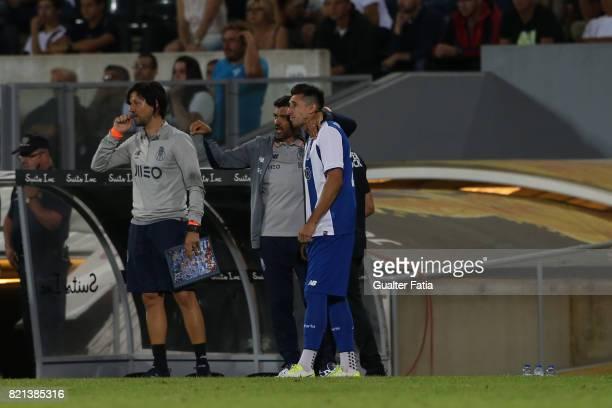 Porto head coach Sergio Conceicao talks to FC Porto midfielder Hector Herrera from Mexico during the PreSeason Friendly match between Vitoria de...