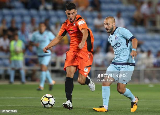 Porto midfielder Andre Andre from Portugal with Portimonense SC midfielder Pedro Sa from Portugal in action during the PreSeason Friendly match...