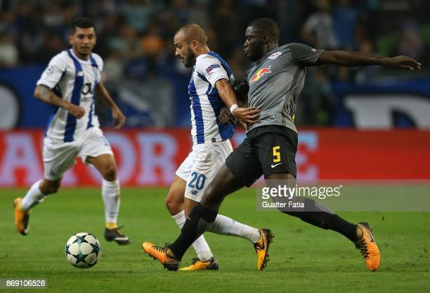Porto midfielder Andre Andre from Portugal with RB Leipzig defender Dayot Upamecano from France in action during the UEFA Champions League match...