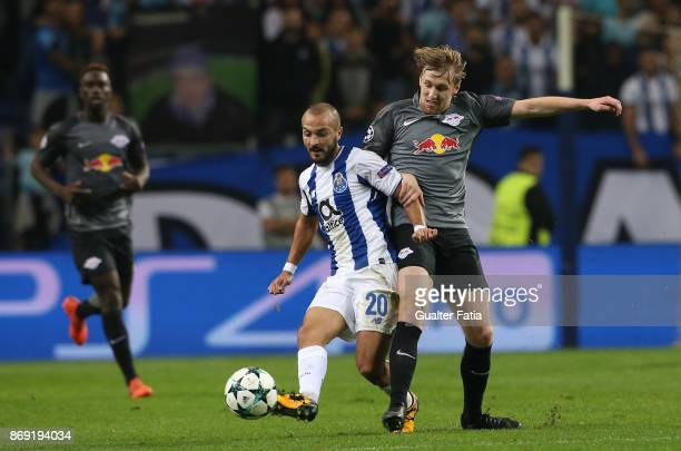 Porto midfielder Andre Andre from Portugal with RB Leipzig forward Emil Forsberg from Sweden in action during the UEFA Champions League match between...