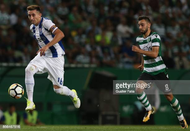 Porto midfielder Hector Herrera from Mexico with Sporting CP midfielder Bruno Fernandes from Portugal in action during the Primeira Liga match...