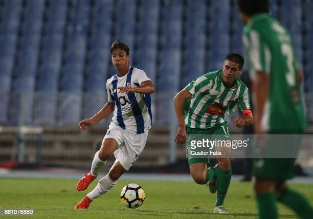 Porto midfielder Oliver Torres from Spain with Lusitano Ginasio Clube midfielder Ricardo Ferro from Portugal in action during the Portuguese Cup...
