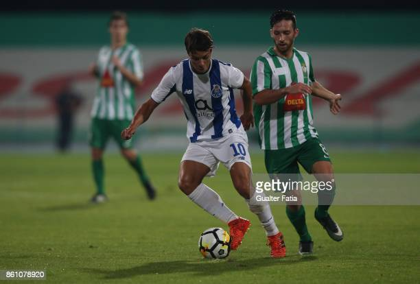 Porto midfielder Oliver Torres from Spain with Lusitano Ginasio Clube midfielder Francisco Serrano from Portugal in action during the Portuguese Cup...