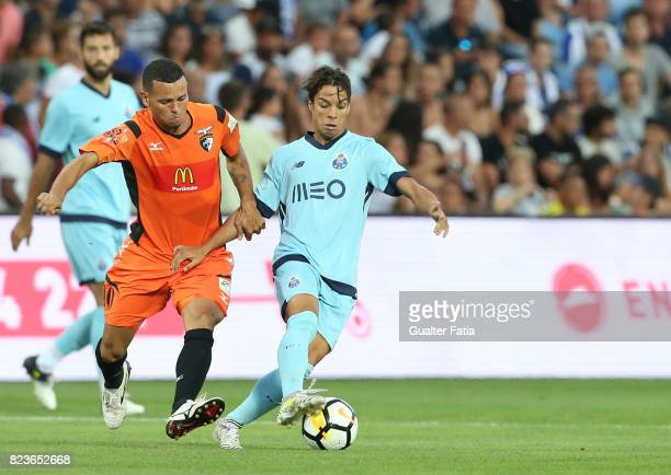 Porto midfielder Oliver Torres from Spain with Portimonense SC midfielder Ewerton Pereira from Brazil in action during the PreSeason Friendly match...