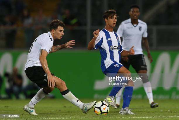 Porto midfielder Oliver Torres from Spain with Vitoria Guimaraes forward Fabio Sturgeon from Portugal in action during the PreSeason Friendly match...