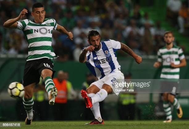 Porto midfielder Sergio Oliveira from Portugal with Sporting CP midfielder Rodrigo Battaglia from Argentina in action during the Primeira Liga match...