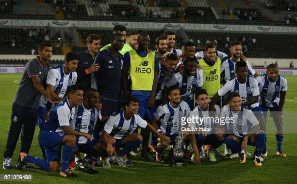 Porto players pose for a team photo with trophy after winning the Algarve Football Cup the PreSeason Friendly match between Vitoria de Guimaraes and...