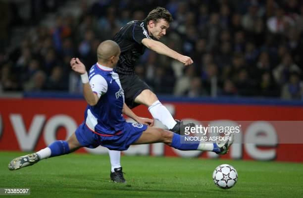 Chelsea's Andriy Shevchenko scores the equaliser past Porto's Pepe during their Champions League first leg knockout round football match at the...
