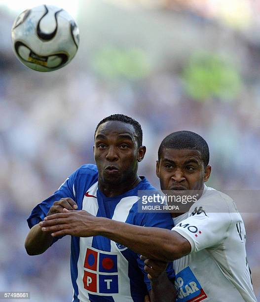 FC Porto South African Bennedith McCarthy vies with Vitoria SC's Victor Moreno during their Portuguese Super League match at Dragao Stadium in Porto...