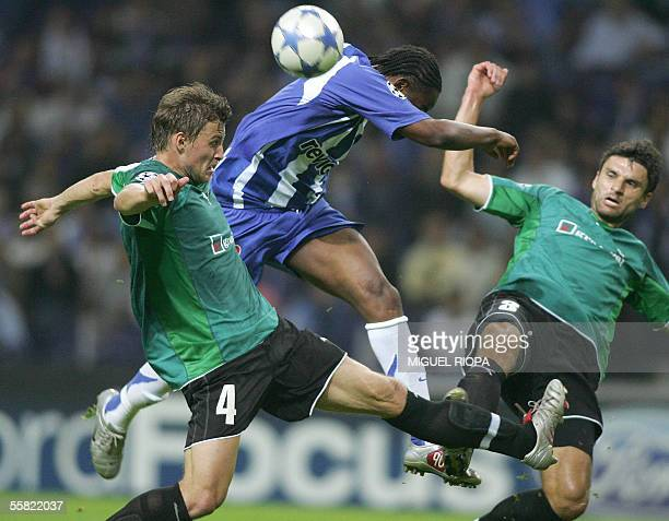 FC Porto's South African Benny McCarthy tries to score next to FC Artmedia's Jan Durica and Blazej Vascak during their matchday 2 Champions League...