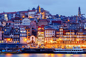 A view of the Ribeira embankment in the night illumination. Porto. Portugal.