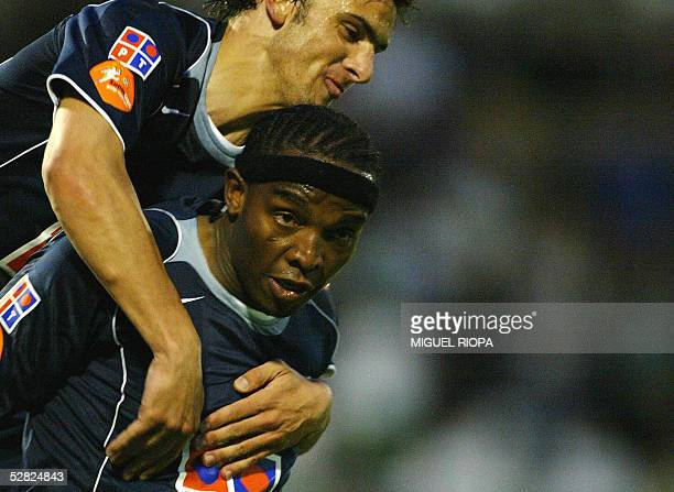 Porto South African Benny McCarthy celebrates with teammate Helder Postiga after scoring against Rio Ave FC during a Portuguese superleague football...