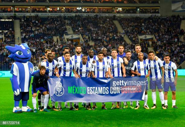 FC Porto team pose holding a banner reading 'Mexico we are with you' before the Portuguese league football match FC Porto vs Portimonense at the...