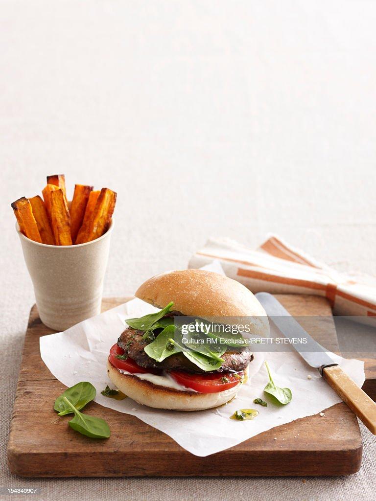 Portobello burger with sweet potatoes : Stock Photo