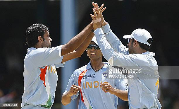 India Cricketer Yuvraj Singh and Rahul Dravid congratulate Munaf Patel for the wicket of Sri Lankan Cricketer Tillakaratne Dilshan at the Queen's...