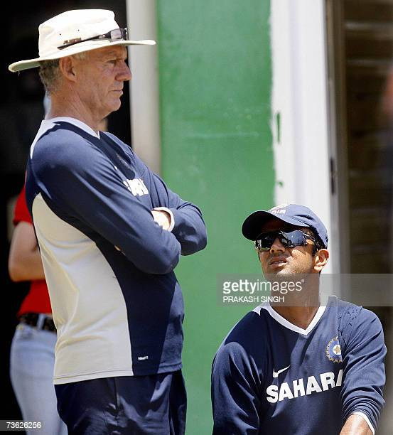 Indian cricket captain Rahul Dravid talks with coach Greg Chappell during a training session at the Queen's Park Oval stadium in PortofSpain 18 March...