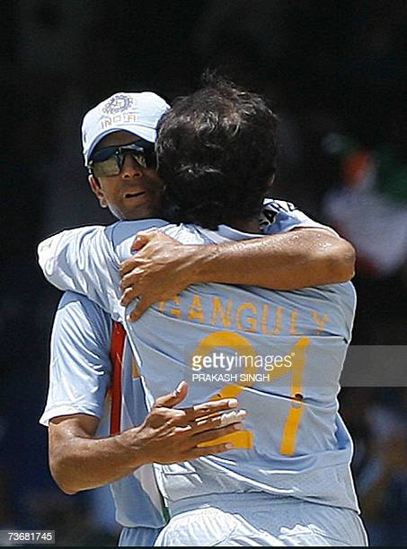Indian Cricket Captain Rahul Dravid congratulates Saurav Ganguly for the wicket of Sri Lankan Cricketer Kumar Sangakkara at the Queen's Park Oval in...
