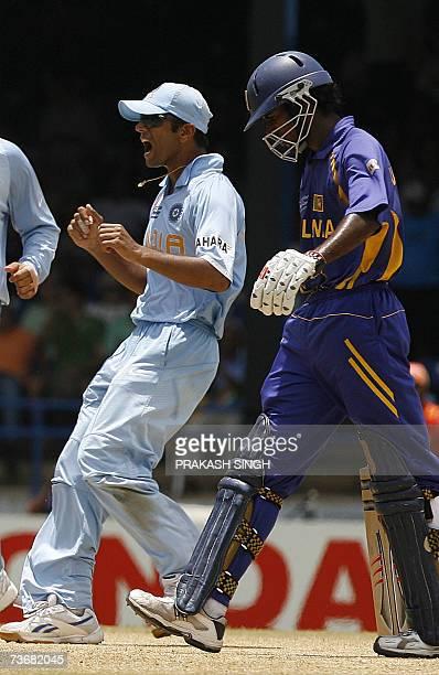 Indian Cricket Captain Rahul Dravid celebrates the wicket of Sri Lankan Cricketer Upul Tharanga off Sachin tendulkar at the Queen's Park Oval in Port...