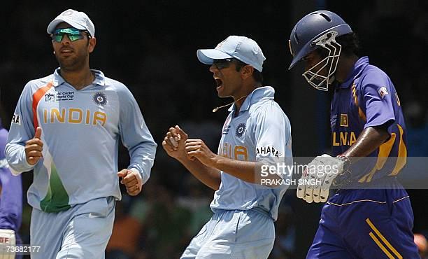 Indian Cricket Captain Rahul Dravid and Yuvraj Singh celebrate the wicket of Sri Lankan Cricketer Upul Tharanga off Sachin tendulkar at the Queen's...