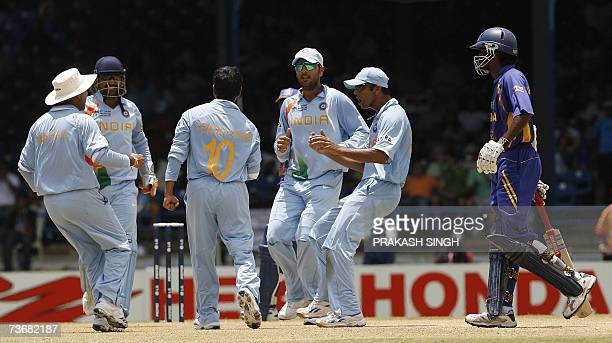 Indian Cricket Captain Rahul Dravid Yuvraj Singh Sachin tendulkar Virendra Sehwag and Mahendra Singh Dhoni celebrates as Sri Lankan Cricketer Upul...