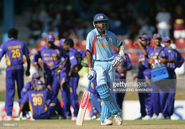 Indian cricket captain Rahul Dravid gestures in between wickets as his team faces a batting collapse against Sri Lanka at the Queen's Park Oval in...