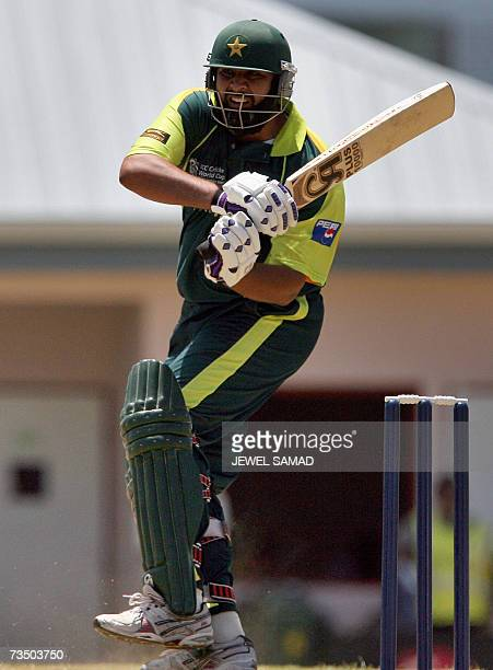 Pakistani cricketer InzamamulHaq hits a ball off Canadian bowler Henry Osinde during a warmup match of the ICC World Cup Cricket 2007 between...